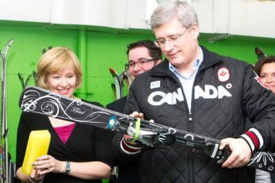 Harper prepares skis.jpg